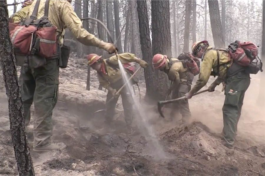 Fire fighters establish a fire line