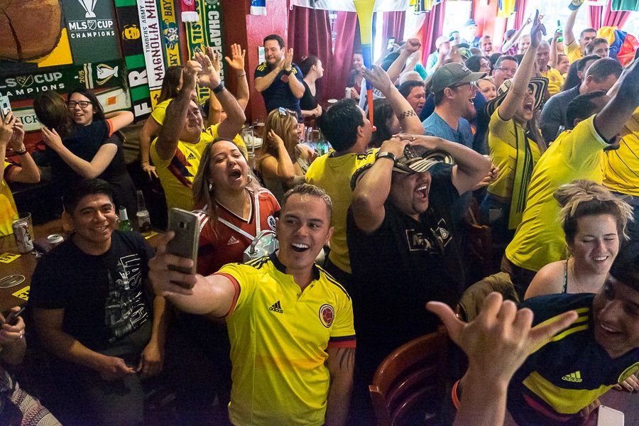 Crowds cheer at the 442 Soccer Bar in Portland for the match of Columbia vs Poland.