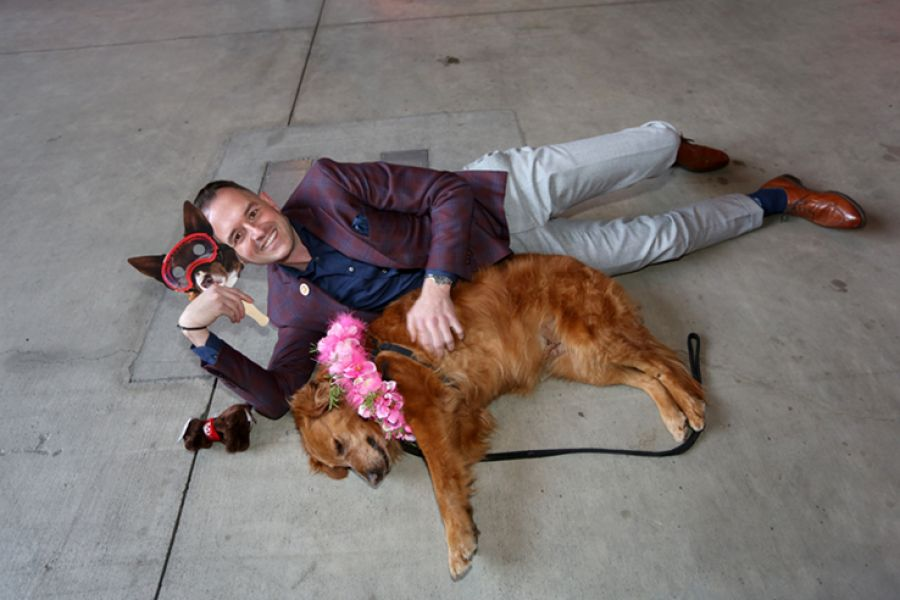 Brian Garish, CEO of Banfield Pet Hospital, cuddles up with a furry friend at the company's Vancouver, Wash.-based headquarters