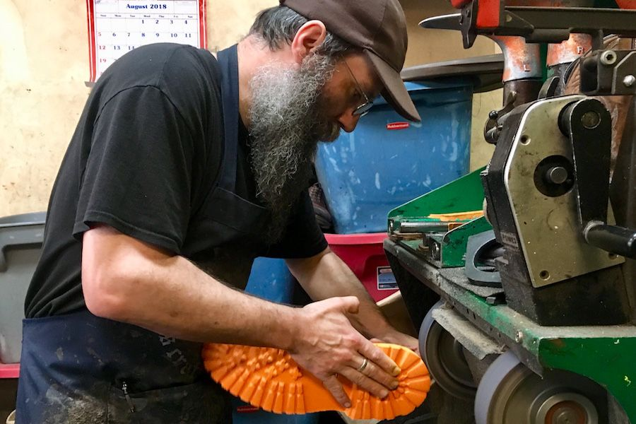 Dorian Butcher repairs a shoe in his downtown shop