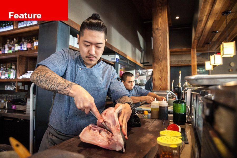 Chef Jeff Kim breaks down a fish at the downtown Portland Bamboo Sushi